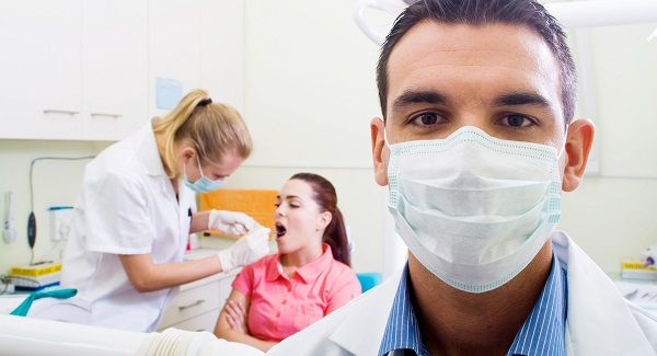 male-dentist-in-office-male-dentist-dental-checkup-a